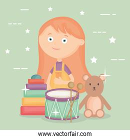 little girl playing with drum and bear teddy
