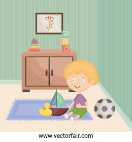 little boy playing with toys in the room