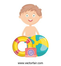 little boy with swimsuit and balloon beach toy