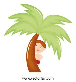 little boy with swimsuit and tree palm