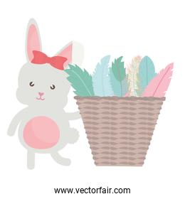 cute little rabbit with basket straw and feathers