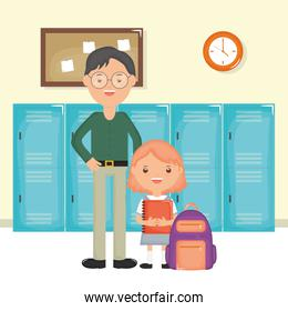 young male teacher with student girl in the school