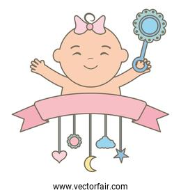 cute little baby girl with maracas and decorative mobile