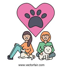 young girls with cute cat and dog mascots