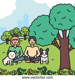 young couple with little dogs in the park