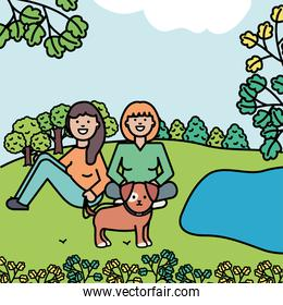 young women with little dog in the park