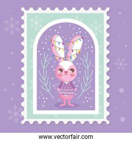rabbit with lights tangled in the ears branch snow merry christmas stamp