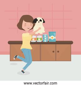 woman holding dog with food in the room pet care
