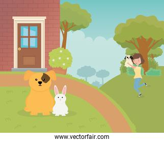 woman carrying her dog and mascots sitting pet care