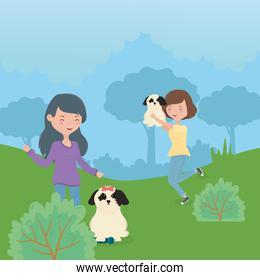women with dogs playing park pet care