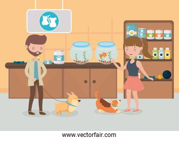 man and woman with her dogs in the vet pet care