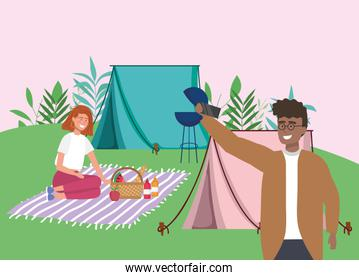 man using smartphone woman in blanket tent camping picnic
