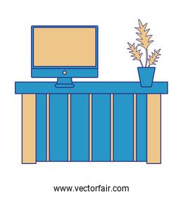 full color wood desk with computer screen and plant