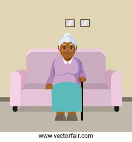 Grandmother seated on armchair