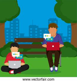 Young mens seated at park with laptop