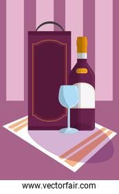 Wine bottle with cup on tablecloth