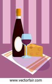 Wine bottle and cup with cheese