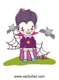 boy with vampire costume and bats with spiders