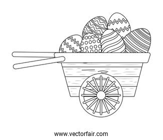 easter egg in wooden wheelbarrow