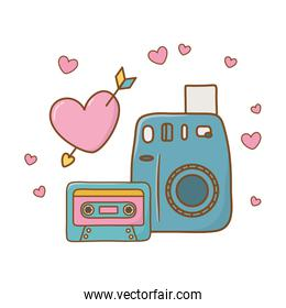 camera cassette and heart with arrow