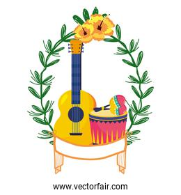 guitar with drum and maracas on laurel wreath