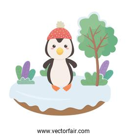 Penguin cartoon with hat in snowscape