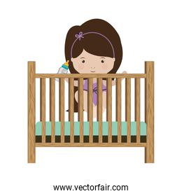 girl standing in crib with baby bottle