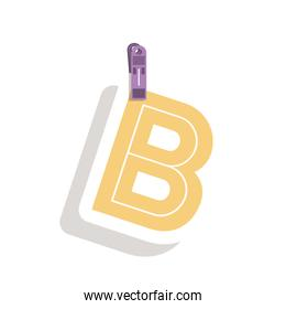 Clothespin holding relive letter b in shade