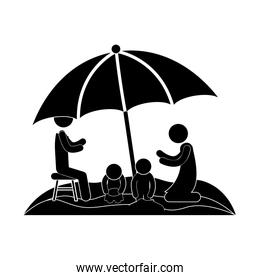 family in beach with umbrella