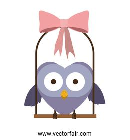 swing decorate with pink bow and owl standing
