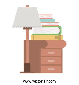 wooden drawer with lamp and books