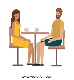 couple drinking coffee in the living room