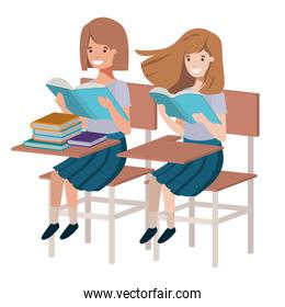 young student girls reading in school desk