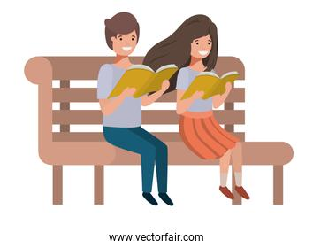 young students sitting reading book