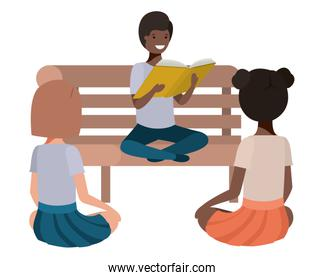 young ethnicity students sitting reading book