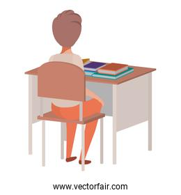 young student boy sitting in school desk