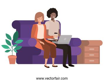 couple sitting in the living room with laptop