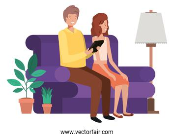 couple sitting in the living room with tablet