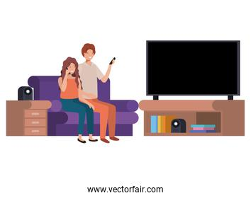 woman and man sitting in the living room with smartphone