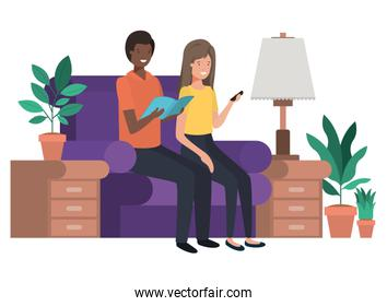 couple sitting in the living room with smartphone