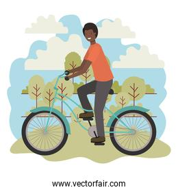 young black man in bicycle in the park