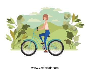 young woman in bicycle on the park