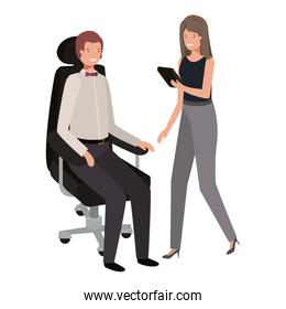 man sitting in office chair and woman with tablet