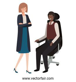 man sitting in office chair and woman standing
