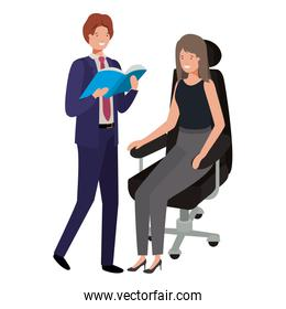 woman sitting in office chair and man with book