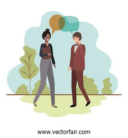 business couple with speech bubble in landscape