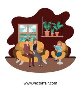 parents couple with daugether sitting in livingroom