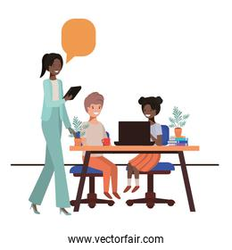 female teacher in the classroom with students and speech bubble