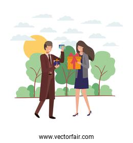 couple with gift box and coin purse in landscape