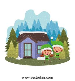house with pine trees falling snow and couple of elves